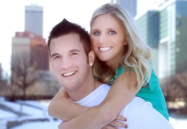 Fun engagement photo in downtown Omaha by M.J.B.